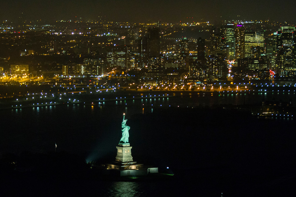 . A view of the Statue of Liberty during a visit by President Barack Obama, on Tuesday, Oct. 7, 2014, in New York.  (AP Photo/Evan Vucci)
