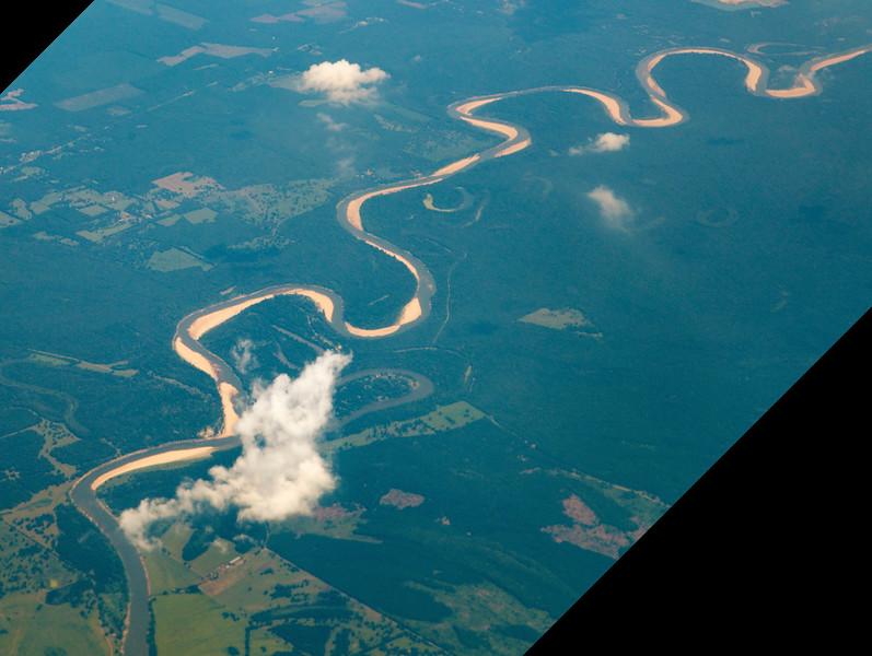 A meandering bayou below us