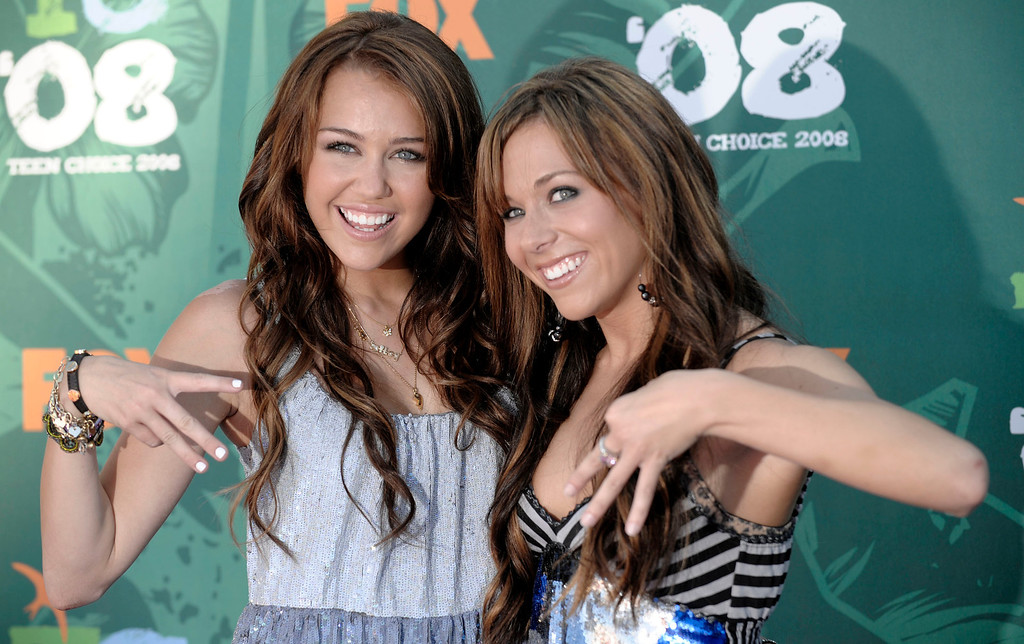 . Miley Cyrus, left, and her mother, Leticia arrive at the Teen Choice Awards in Universal City, Calif., on Sunday Aug. 3, 2008. (AP Photo/Chris Pizzello)