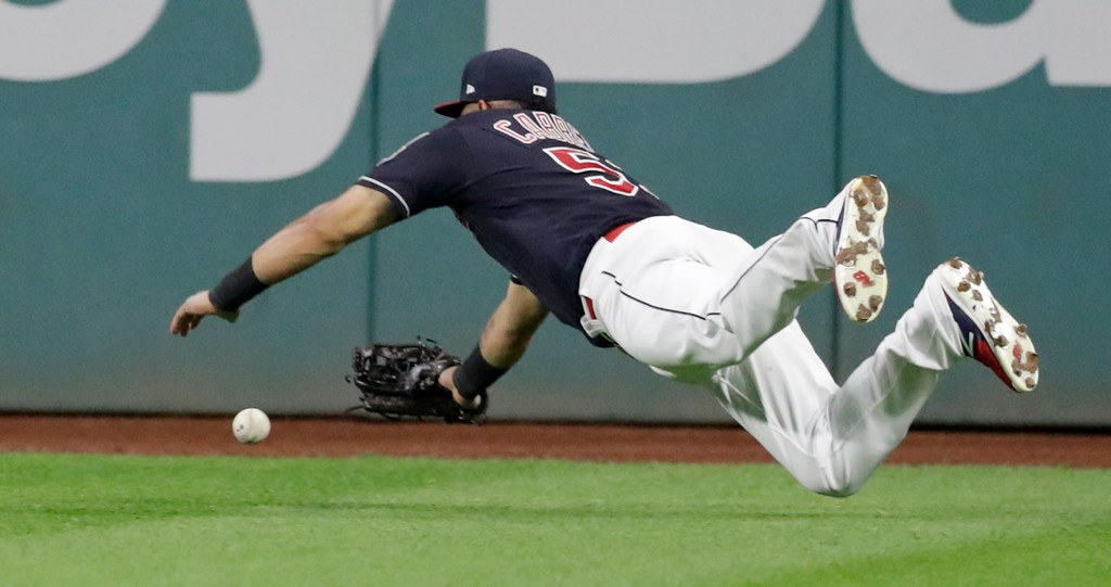 . Cleveland Indians\' Melky Cabrera dives for a ball hit by Minnesota Twins\' Robbie Grossman in the sixth inning of a baseball game, Wednesday, Aug. 29, 2018, in Cleveland. Grossman doubled on the play. (AP Photo/Tony Dejak)