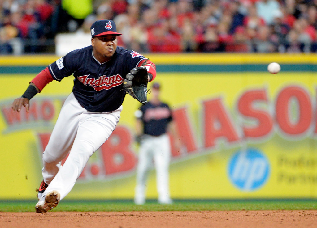 . Cleveland Indians\' Jose Ramirez fields a ball hit by New York Yankees\' Starlin Castro during the second inning of Game 5 of a baseball American League Division Series, Wednesday, Oct. 11, 2017, in Cleveland. Castro was out on the play. (AP Photo/Phil Long)