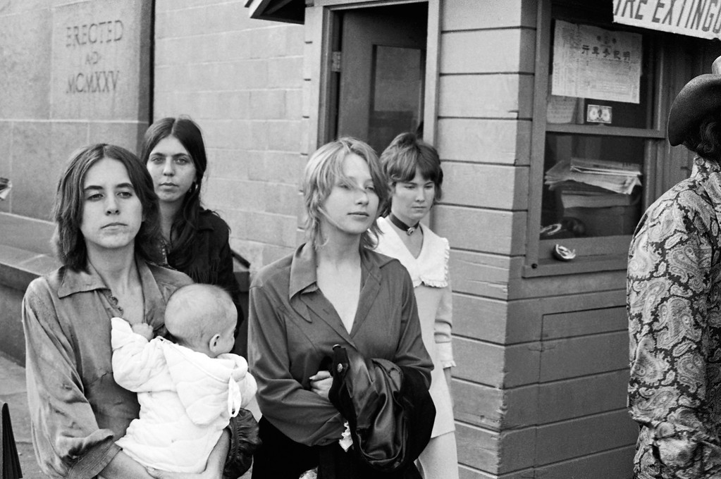 ". Young people who identified themselves as members of the Charles Manson ""family\"" leave a Los Angeles courtroom where the hippie-style cult leader was recorded as pleading innocent to charges of murdering actress Sharon Tate and six others, Jan. 29, 1970.  Some members of the group gave newsmen their names as Gypsy, Cappy and Squeaky.  (AP Photo)"
