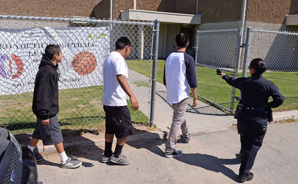 . Harbor area students who should have been in school were marched into Normandale Park gym where they were processed and spoke with councelers until a parent could pick them up. Photo by Brad Graverson 4-10-13