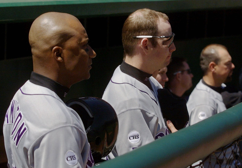 . From left, the Colorado Rockies\' Darryl Hamilton, Pat Watkins, and Jeff Reed, listen to the national anthem while wearing patches remembering those killed at Columbine High School in Littleton, Colorado, prior to their game against the San Francisco Giants in San Francisco, Thursday, April 22, 1999. (AP Photo/Eric Risberg)