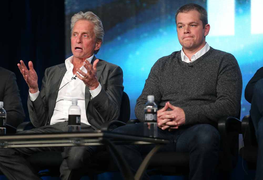 "Description of . Actors Michael Douglas (L) and Matt Damon speak onstage during the ""Behind the Candelabra\"" panel discussion at the HBO portion of the 2013 Winter TCA Tourduring 2013 Winter TCA Tour - Day 1 at Langham Hotel on January 4, 2013 in Pasadena, California.  (Photo by Frederick M. Brown/Getty Images)"