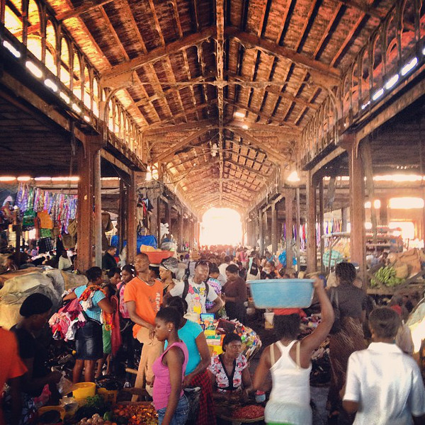 Cap-Haïtien central market. A covered market whose red wrought-iron gates and roof open to a world of managed chaos and Vodou mysticism. A sea of people end to end, even on a holiday. via Instagram http://ift.tt/11jLEyL