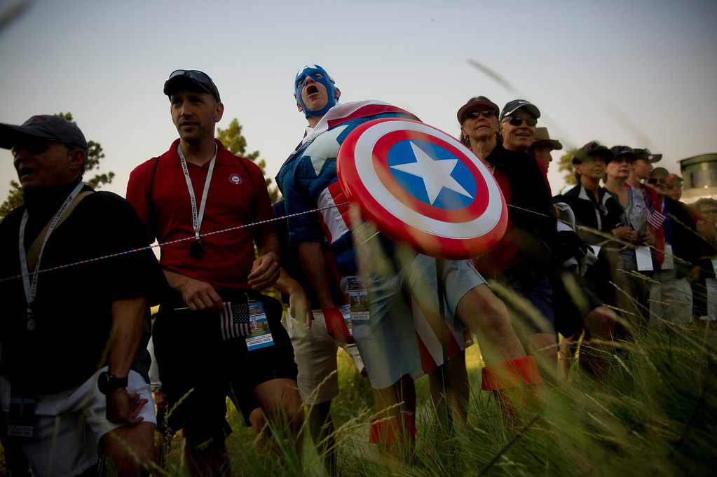 . PARKER, CO - AUGUST 16: Scott Whitney yells to the American team in a Captain America costume on the first tee at the Solheim Cup at Colorado Golf Club, on August 16, 2013.  (Photo By Grant Hindsley/The Denver Post)