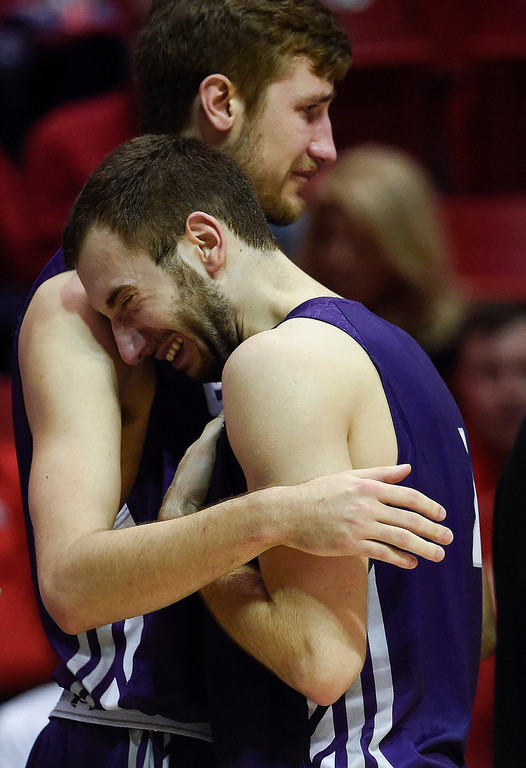 . Stephen F. Austin forward Nikola Gajic, front, embraces teammate guard Thomas Walkup after losing to UCLA in a third-round game of the NCAA college basketball tournament, Sunday, March 23, 2014, in San Diego. UCLA won 77-60. (AP Photo/ Denis Poroy)
