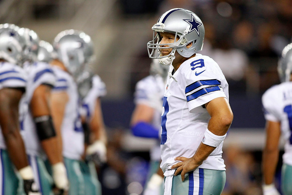 . Dallas Cowboys quarterback Tony Romo (9) waits between plays after Dallas was penalized against the Philadelphia Eagles in the first half of their NFL football game in Arlington, Texas December 2, 2012.  REUTERS/Mike Stone