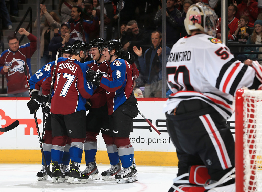 . DENVER, CO - MARCH 08:  The Colorado Avalanche celebrate a goal by Jamie McGinn #11 of the Colorado Avalanche against goalie Corey Crawford #50 of the Chicago Blackhawks to give the Avalanche a 5-1 lead in the second period at the Pepsi Center on March 8, 2013 in Denver, Colorado.  (Photo by Doug Pensinger/Getty Images)