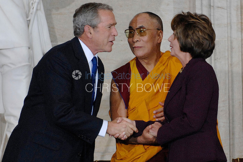 His Holiness The Dalai Lama  greets Speaker of The House Nancy Pelosi and President Bush as they all shake hands in the Capitol.
