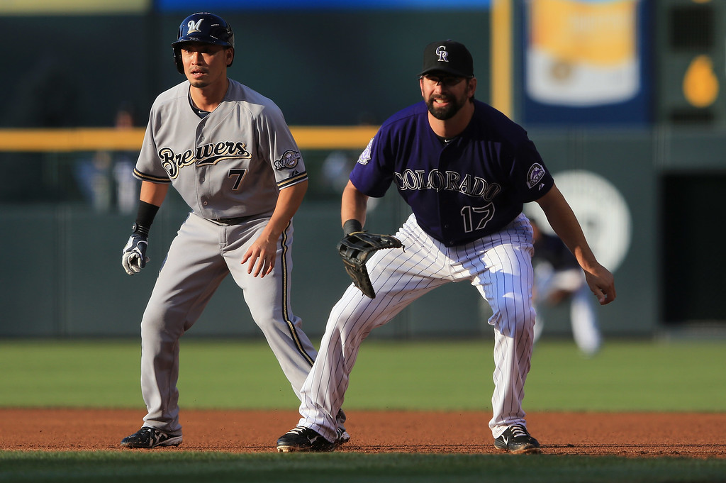 . DENVER, CO - JULY 26:  Norichika Aoki #7 of the Milwaukee Brewers leads off first base after a single as first baseman Todd Helton #17 of the Colorado Rockies plays defense in the first inning at Coors Field on July 26, 2013 in Denver, Colorado.  (Photo by Doug Pensinger/Getty Images)