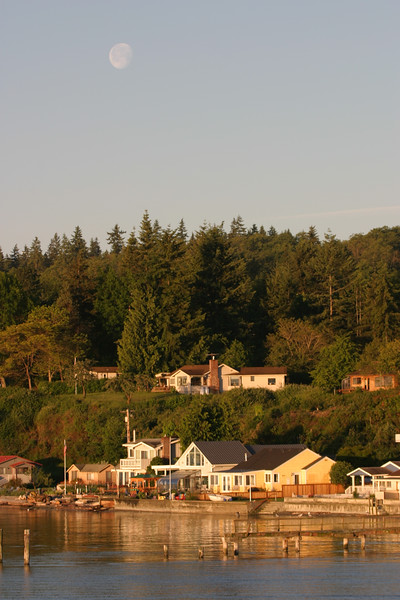 A full moon sets over Whidbey Island