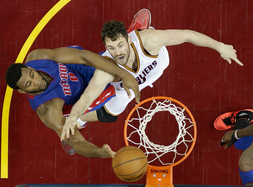 . Detroit Pistons\' Andre Drummond (0) drives to the basket against Cleveland Cavaliers\' Kevin Love (0) during the second half in Game 2 of a first-round NBA basketball playoff series, Wednesday, April 20, 2016, in Cleveland. The Cavaliers won 107-90. (AP Photo/Tony Dejak)