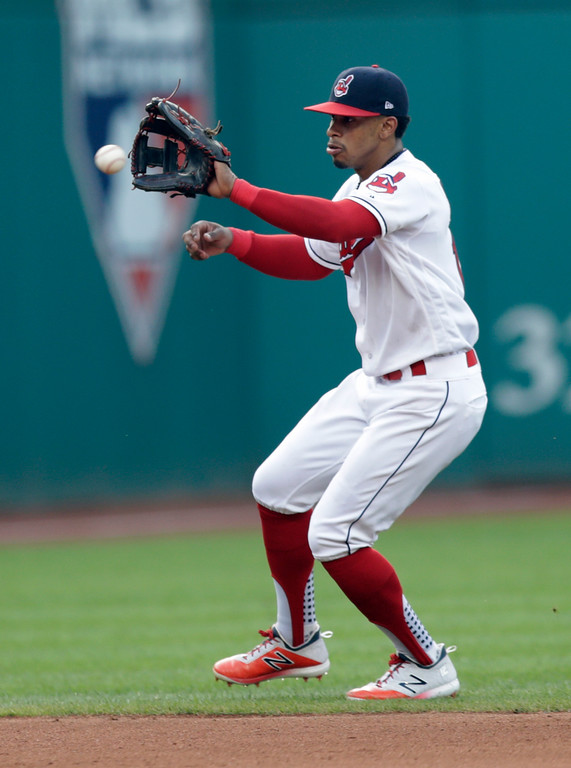 . Cleveland Indians\' Francisco Lindor fields a ball hit by Kansas City Royals\' Cam Gallagher in the seventh inning of a baseball game, Monday, Sept. 3, 2018, in Cleveland. Gallagher was out on the play. (AP Photo/Tony Dejak)