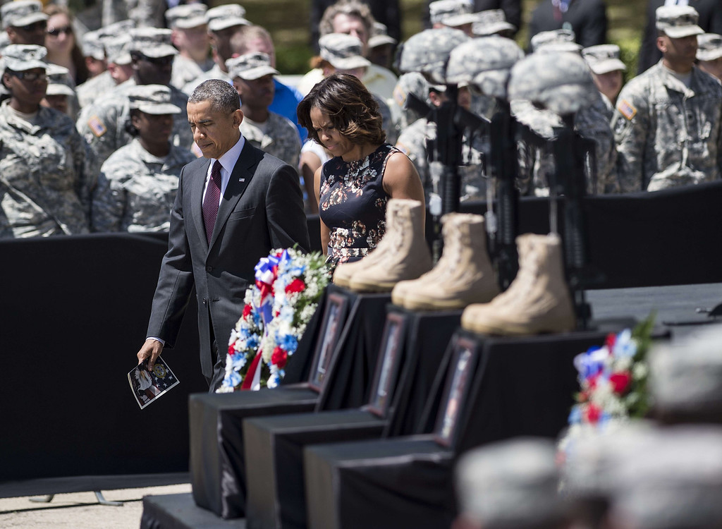 . US President Barack Obama and First Lady Michelle Obama arrive for a memorial service at Fort Hood April 9, 2014 in Texas.   AFP PHOTO/Brendan  SMIALOWSKI/AFP/Getty Images