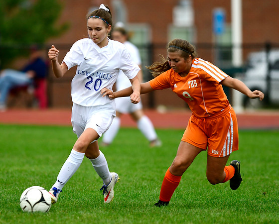 9/13/2018 Mike Orazzi | Staff Lewis Mills' Julia Malejczyk (20) and Terryville's Lena Stefano (9) during Thursday's soccer at THS
