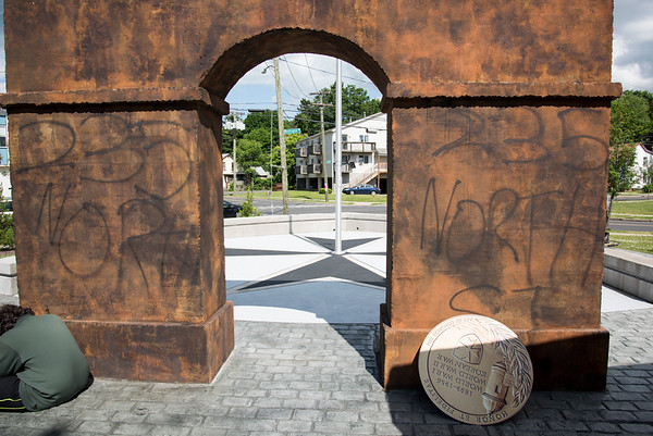 06/06/19 Wesley Bunnell | Staff The monument on Washington St. dedicated to the 65th Infantry Division Borinqueneers as it appears on Thursday afternoon after being vandalized. What appears to be spray paint with 235 North St is painted several times and a large medallion has been ripped from a wall.