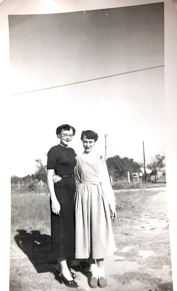 That is Kate Gill on the Right. Not sure on the left. This photo was unlabeled on the back, but another photo had a picture of this same lady on the right and it was labeled Kate or Kati Gill