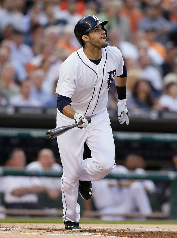 . Detroit Tigers\' J.D. Martinez watches his sacrifice fly to right field which scored Torii Hunter during the first inning of a baseball game against the Kansas City Royals in Detroit, Tuesday, Sept. 9, 2014. (AP Photo/Carlos Osorio)