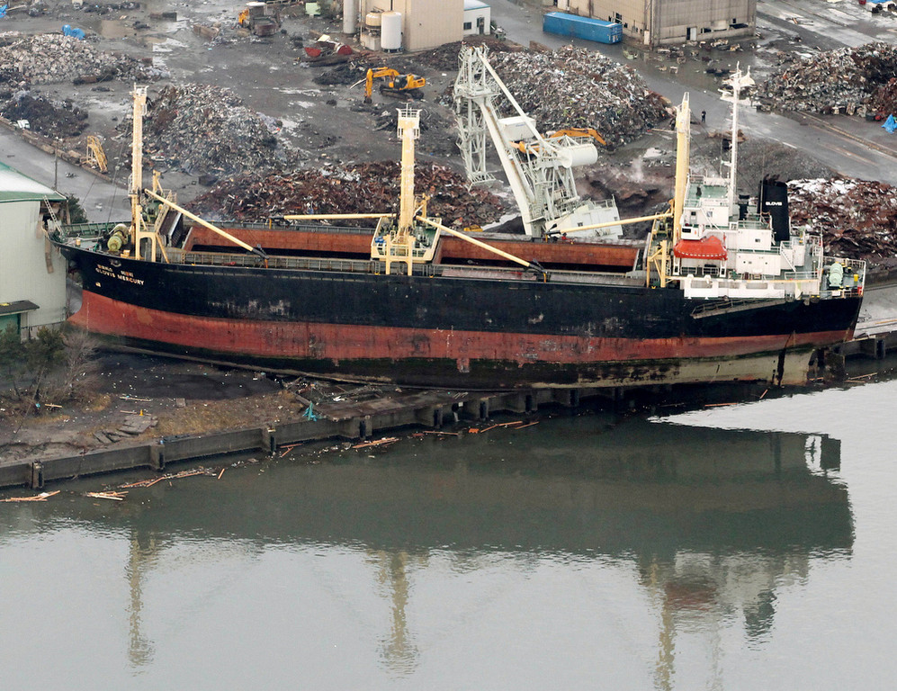 . A tsunami-drifted ship sits on a pier in Sendai, Miyagi Prefecture, Saturday morning, March 12, 2011 after Japan\'s biggest recorded earthquake slammed into its eastern coast Friday. (AP Photo/Kyodo News)