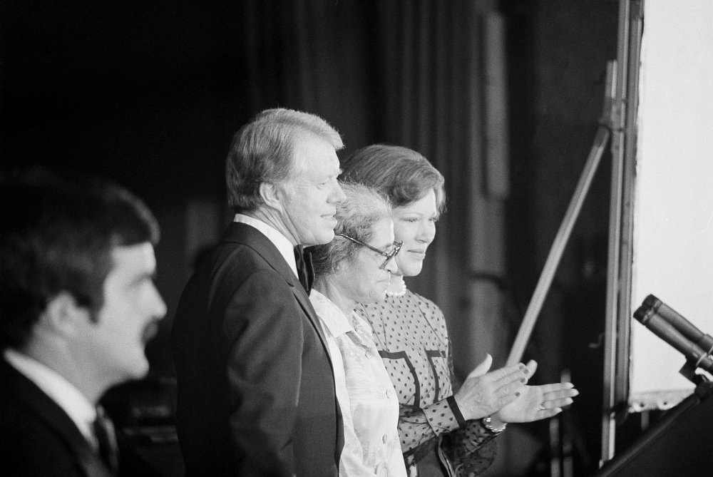 Description of . Rosalynn Carter applauds as President Jimmy Carter introduces former civil rights protester Rosa Parks at the conclusion of Carter's speech before the annual Congressional Black Caucus dinner in Washington on Sept. 30, 1978. (AP Photo/Charles Tasnadi)
