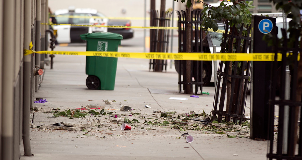 . Beer cups and building debris litter the sidewalk at the scene of a balcony collapse at an apartment building on Kittredge Street in Berkeley, Calif., Tuesday, June 16, 2015. Six people were killed. (D. Ross Cameron/Bay Area News Group)