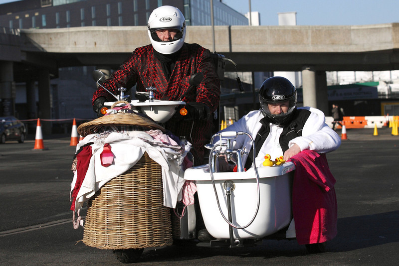 ". Former England cricketer Andrew ""Freddie\"" Flintoff (R) sits in a bath-tub sidecar with British inventor Edd China (L) at the controls as they try to break the fastest toilet world record at Wembley Stadium in London on March 19, 2012. Flintoff was attempting to set twelve Guinness World Records in 12 hours to raise money for the Sport Relief charity.AFP PHOTO / JUSTIN TALLIS"