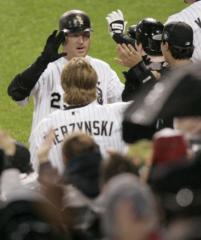 . Chicago White Sox\'s Jim Thome celbrates with teammates after hitting a two-run homer during the fourth inning of an MLB baseball game against the Cleveland Indians Sunday, April 2, 2006, in Chicago. The home run helped the White Sox to a 10-4 opening day win. (AP Photo/Nam Y. Huh)