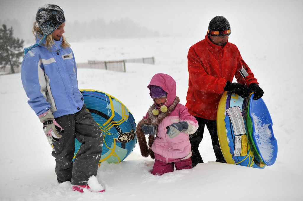. TINY TOWN, CO. - MARCH 09: Tyler McCarty of Littleton, right, is heading to the parking after sledding with his daughers Abby, 8, left, and Brook, 5, at Meyer Ranch Park. March 9, 2013. Tiny Town, Colorado. (Photo By Hyoung Chang/The Denver Post)