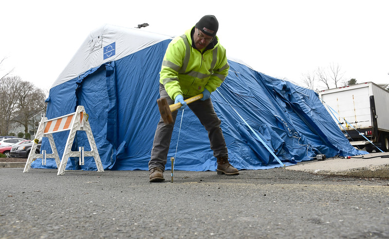 3/25/2020 Mike Orazzi | Staff Bristol Hospital employee Steve Oakes while setting up a tent outside the emergency room entrance today that will be used to triage COVID-19 patients.