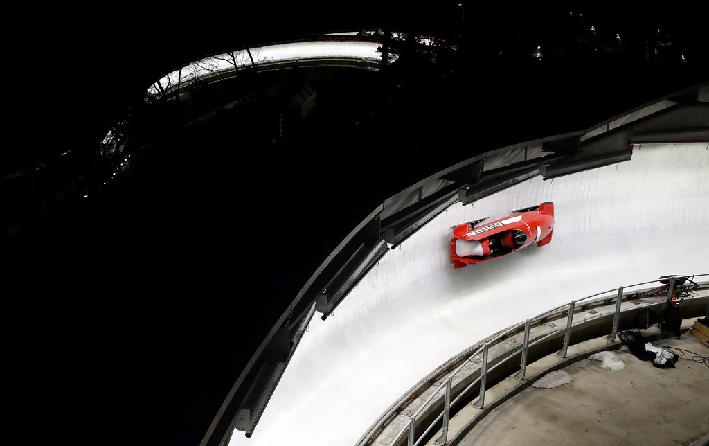 . Driver Katrin Beierl and Victoria Hahn of Austria take a curve in their second heat during the women\'s two-man bobsled competition at the 2018 Winter Olympics in Pyeongchang, South Korea, Tuesday, Feb. 20, 2018. (AP Photo/Wong Maye-E)