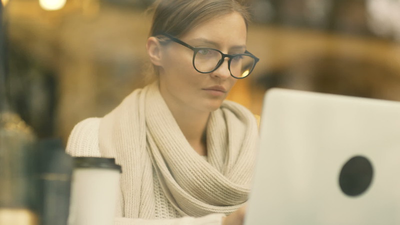 young-freelance-business-lady-working-with-laptop-DGL4CKH.mov