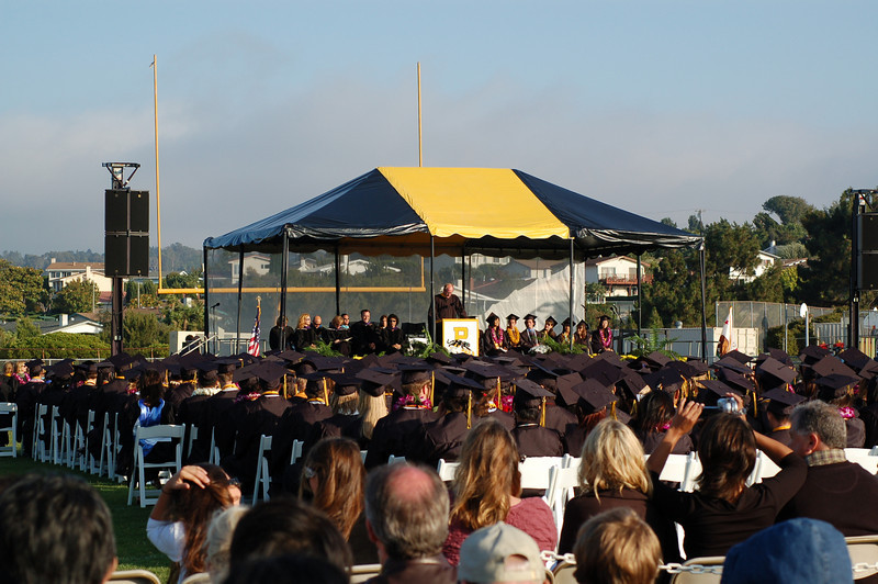 Mr. Kelly Johnson, presents the Class of 2008. Class is accepted by Mr. Larry Vanden Bos (Vice President, Board of Education of PVPHS).  Once again, Palos Verdes Peninsula High School has been ranked in Newsweek as one of the finest public high schools in the nation.  Garnering the 172nd spot out of 29, 000 public high schools in the U.S., PEN HIGH ranked #5 in California of comprehensive high schools (not charter or magnet schools). Nationwide, 75% of the schools listed above PVPHS have admission requirements and are not comprehensive high schools.  We are proud of the fact we accept all students living in our community which give us tremendous diversity, both academically and culturally.  I believe this fact makes our ranking even more significant.  Public schools are ranked according to a ratio devised by Jay Mathews: the number of Advanced Placement, Intl. Baccalaureate and/or Cambridge tests taken by all students at a school in 2007 divided by the number of graduating seniors. All of the schools on the list (1425) have an index of at least 1.000, meaning they gave at least as many tests in 2007 as they had graduates. These schools are in the top 5% of public schools measured this way. 65% of PVPHS' graduating seniors have at least one passing grade on one AP test.  What is especially significant about Peninsula, is the requirement all students in an AP class take the exam. PVPHS has open access to its AP courses, and does not pad its results by only allowing the brightest to take the exams.  All students have the right to stretch and grow.  By experiencing the rigors of reading and writing inherent in the AP course curriculum, our students are better prepared to succeed in college.  Studies by U.S. Department of Education senior researcher Clifford Adelman in 1999 and 2005 showed the best predictors of college graduation were not good high-school grades or test scores, but whether or not a student had an intense academic experience in high school. Such experien