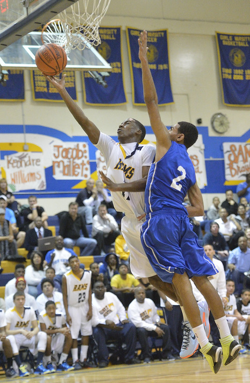 . LONG BEACH, CALIF. USA -- Millikan\'s Mark Thomas (11) takes a shot against Gahr\'s Malachi Hoosein (2) during their CIF-SS Divison 1-A playoff game in Long Beach on February 15, 2013. Millikan defeated Gahr, 74 to 64. Photo by Jeff Gritchen / Los Angeles Newspaper Group
