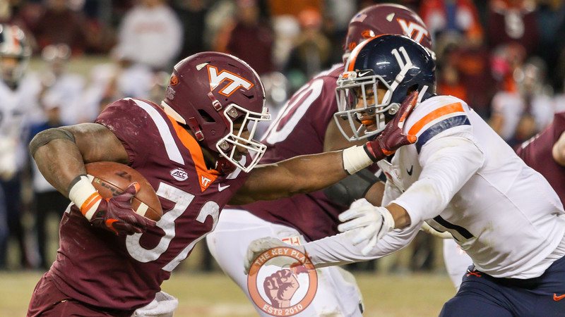 RB Steven Peoples attemps to stiff arm a UVa defender in the 4th quarter. (Mark Umansky/TheKeyPlay.com)