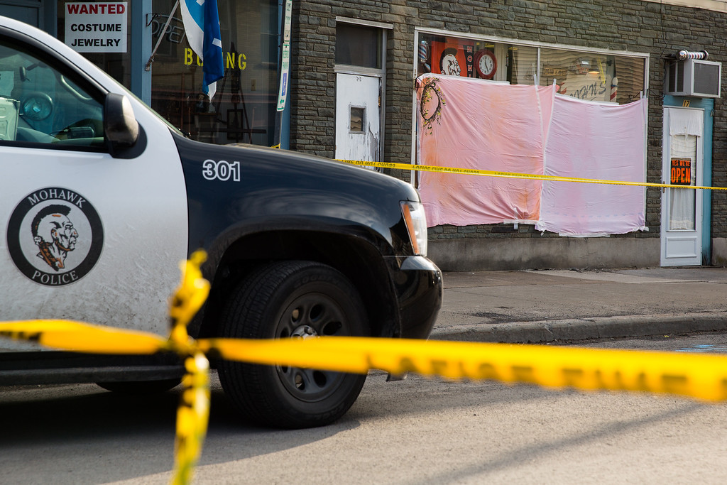 . Police tape cordons off the area around John\'s Barber Shop after a gunman opened fire inside on March 13, 2013 in Mohawk, New York. (Photo by Brett Carlsen/Getty Images)