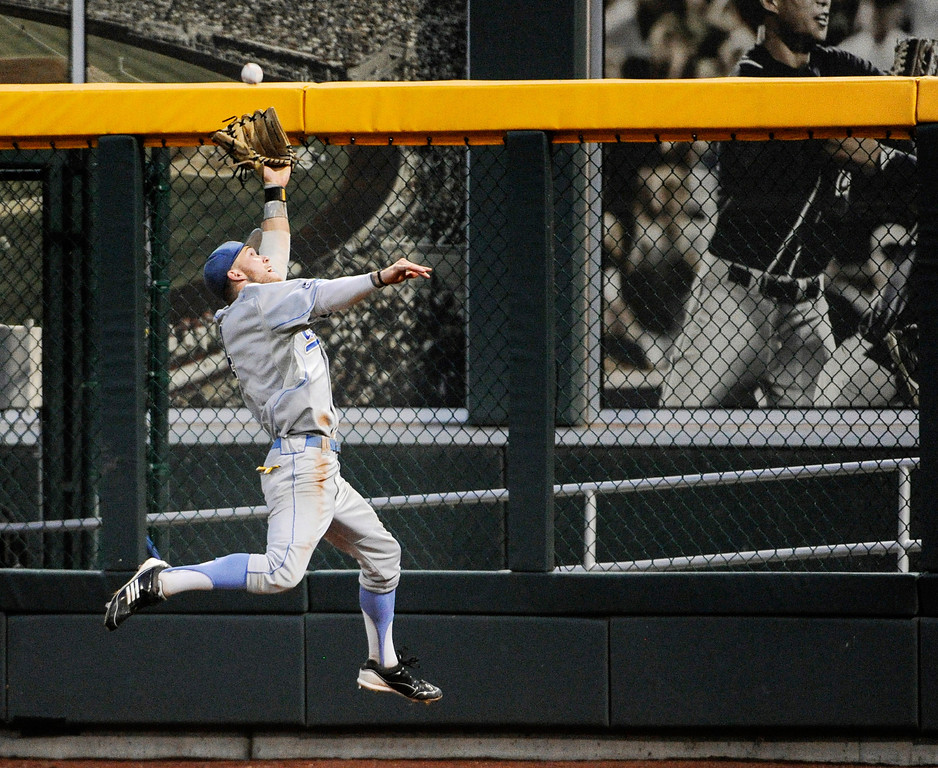 . UCLA right fielder Eric Filia makes a leaping catch of a fly ball hit by Mississippi State\'s Nick Ammirati in the fifth inning of Game 1 in their NCAA College World Series baseball finals, Monday, June 24, 2013, in Omaha, Neb. (AP Photo/Francis Gardler)