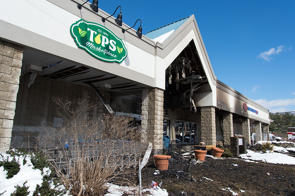 03/04/19 Wesley Bunnell | Staff Fire destroyed Tops Marketplace located at 887 Meriden-Waterbury Tpke in Southington on Monday night. A look down the front facade of the store.