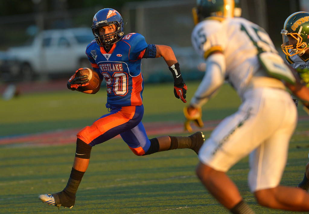 . Chase Jasmin carries the ball for Westlake High against Canyon August 30, 2013 in Westlake Village, CA.(Andy Holzman/Los Angeles Daily News)