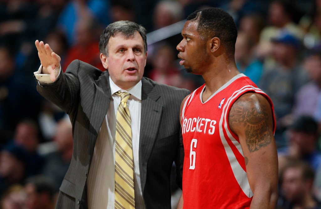 . Houston Rockets coach Kevin McHale, left, confers with forward Terrence Jones during the third quarter of the Denver Nuggets\' 123-116 victory in an NBA basketball game in Denver on Wednesday, April 9, 2014. (AP Photo/David Zalubowski)