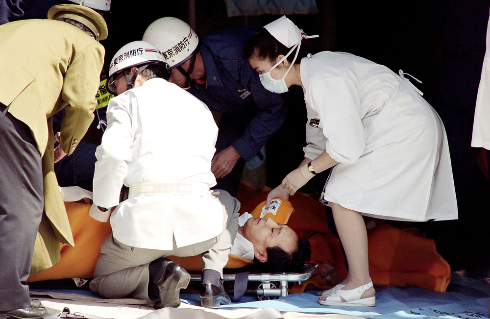 . A commuter is treated by an emergency medical team at a make-shift shelter after being exposed to Sarin gas fumes in the Tokyo subway system during a Aum sect attack on March 20, 1995. Japan\'s top court rejected the final appeal on November 21, 2011 against a death sentence meted out for the deadly 1995 nerve gas attack on the Tokyo subway, leaving 13 members of the Aum Supreme Truth doomsday cult facing the gallows.  The group believed their leader was Christ reincarnated and that they had to defeat the enemies of Japan in order to survive World War III or armageddon. JUNJI KUROKAWA/AFP/Getty Images