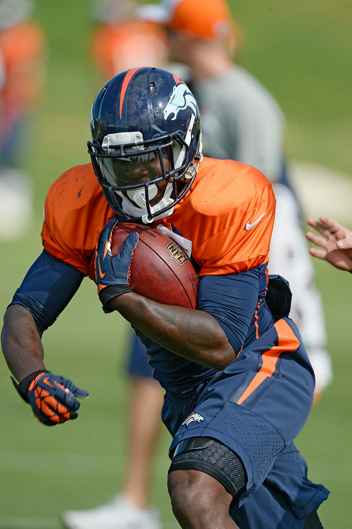 . Denver Broncos running back Ronnie Hillman (23) runs through drills on day 12 of the Denver Broncos 2014 training camp August 5, 2014 at Dove Valley. (Photo by John Leyba/The Denver Post)