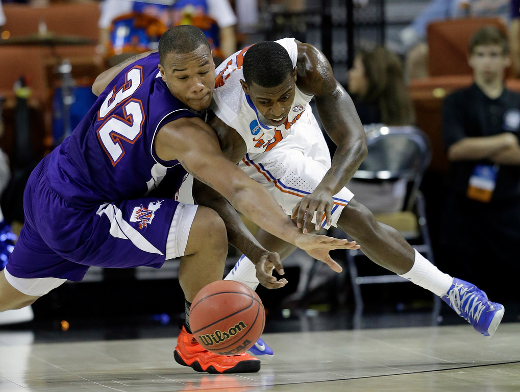. Northwestern State\'s DeQuan Hicks (32) and Florida\'s Casey Prather vie for a loose ball during the first half of a second-round game of the NCAA men\'s college basketball tournament Friday, March 22, 2013, in Austin, Texas.  (AP Photo/David J. Phillip)