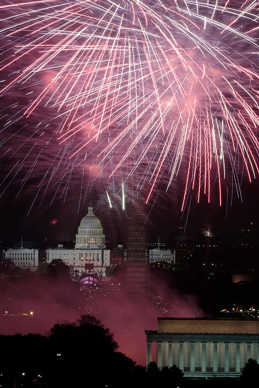 . Fireworks light the sky over the U.S. Capitol, left, the Washington Monument and the Lincoln Memorial during Fourth of July celebrations, Thursday, July 4, 2013 in Washington. Surrounded by scaffolding, the Washington Monument is closed for repairs after an earthquake in 2011. (AP Photo/Alex Brandon)