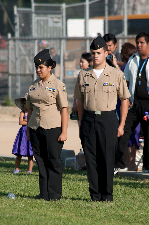 . Reseda High School ROTC stand at attention during the Pledge of Allegiance and National Anthem. The Reseda High School graduation class held their commencement in the school football field on Friday,  June 07, 2013 in Reseda, CA.   Photo by Carlos Carpio