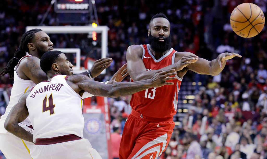 . Houston Rockets guard James Harden (13) passes under pressure from Cleveland Cavaliers forward Jae Crowder (99) and guard Iman Shumpert (4) during the second half of an NBA basketball game Thursday, Nov. 9, 2017, in Houston. (AP Photo/Michael Wyke)