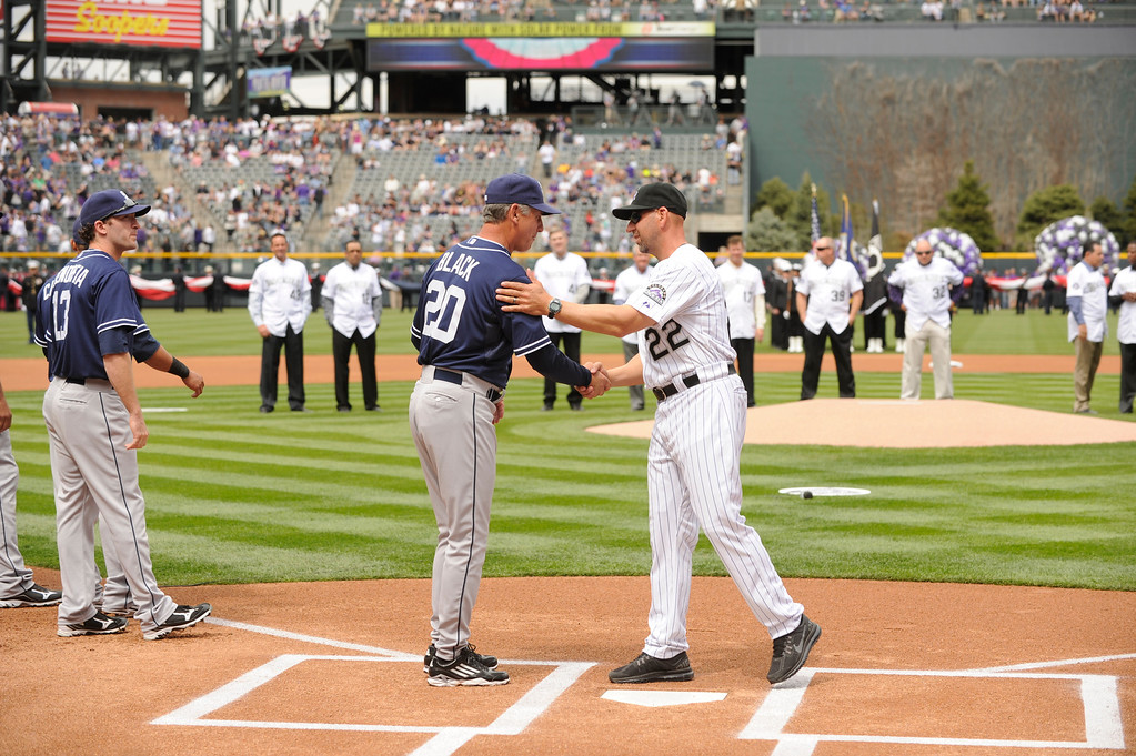 . Colorado Rockies Manager Walt Weiss shakes hands with San Diego Padres Manager Bud Black before the start of the game. (Photo by Karl Gehring/The Denver Post)