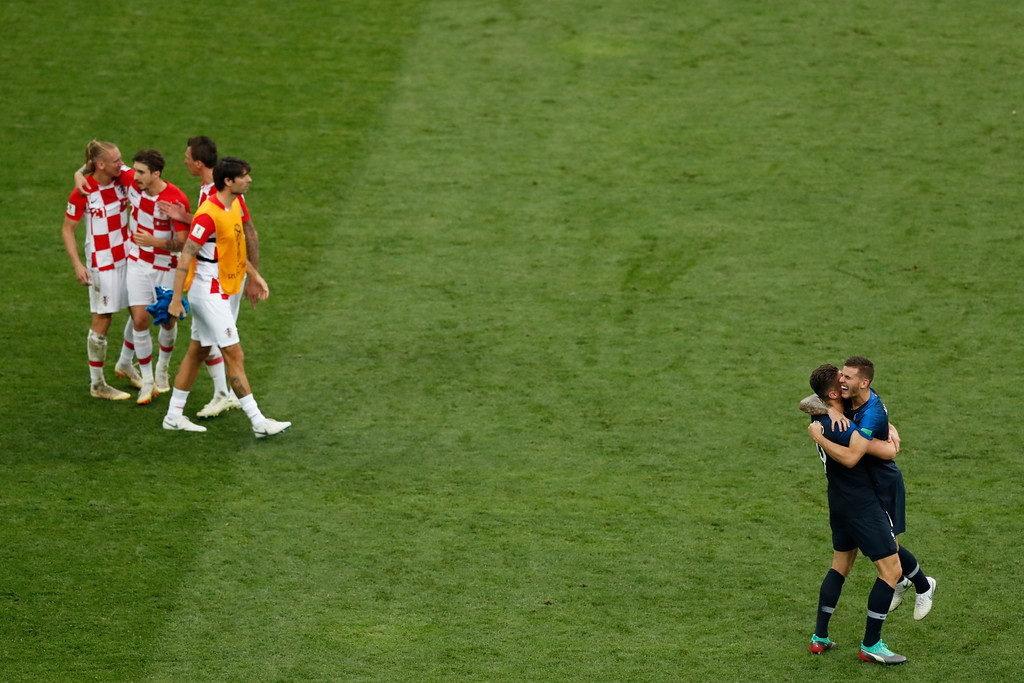 . France\'s Olivier Giroud and Lucas Hernandez celebrate at the end of the final match between France and Croatia at the 2018 soccer World Cup in the Luzhniki Stadium in Moscow, Russia, Sunday, July 15, 2018. (AP Photo/Rebecca Blackwell)