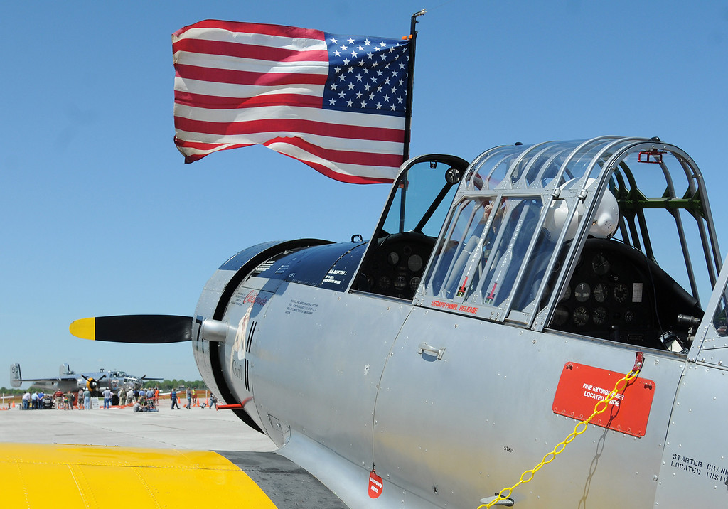 . Jim Bobel/JBobel@MorningJournal.com The flag flys from the cockpit of a Navy SVN-1 Trainer and in the background sits a World War II B-25 bomber the Yankee Warrior.